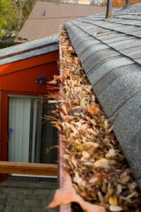 a clogged gutter that needs gutter guards installed
